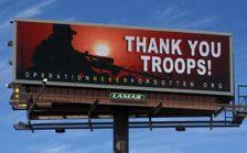 Digital billboards display public service announcements.