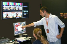 Pictured: Bryan Perry helps direct a game at Iowa State University